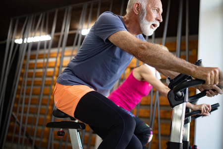 Senior man at the gym doing exercise to stay healthy