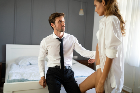 Passionate couple is having sex in a bedroom. Portrait of passion, pleasure, sex, relationship. Stock Photo
