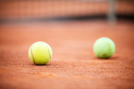 Close up of tennis ball on clay court./Tennis ball