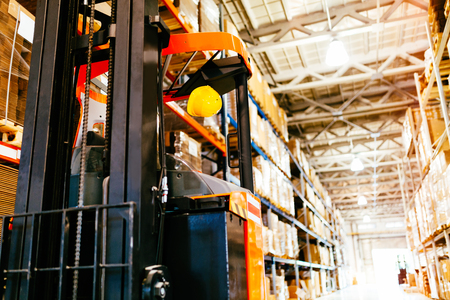 Picture of forklift machine parked in warehouse Banco de Imagens