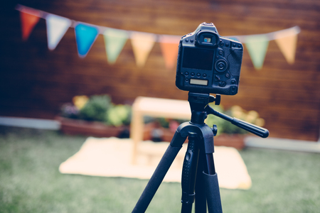 Picture of digital camera placed on tripod