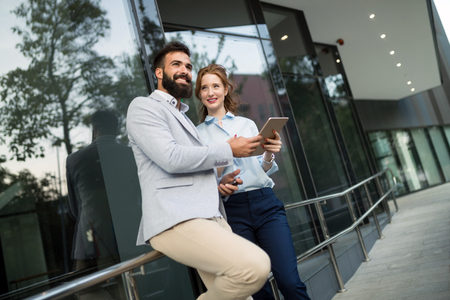 Picture of man and beautiful woman as business partners