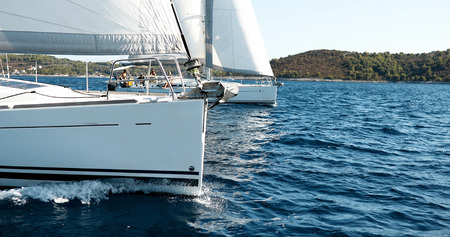 Sailing yachts with white sails in the sea