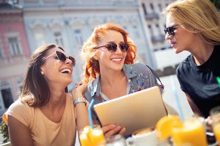 Group of beautiful women smiling and having fun together