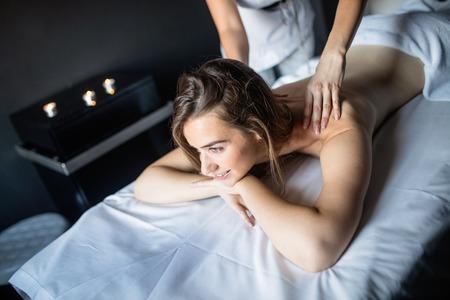 Young woman enjoying massage in spa salon 写真素材 - 120794945