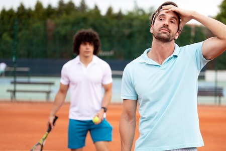 Frustrated tennis player man after fail on tennis court