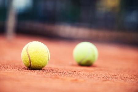 Close up of tennis balls on tennis court. Sport concept