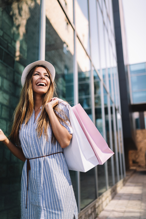 Beautiful woman with shopping bag. Sale, shopping, tourism and happy people concept Stock Photo