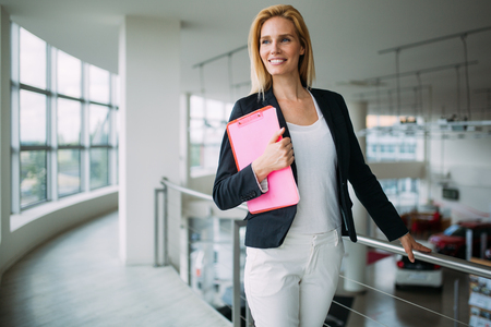 Picture of attractive saleswoman working in company