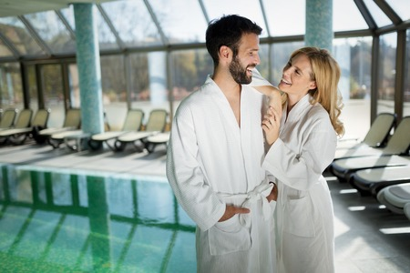 Portrait of attractive couple in spa center