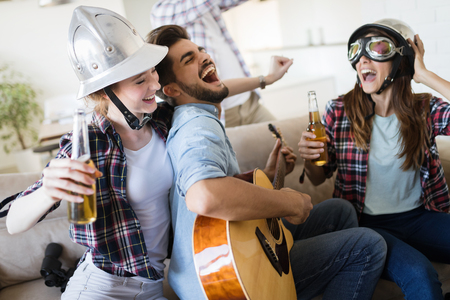 Group of friends playing guitar and partying at home Reklamní fotografie