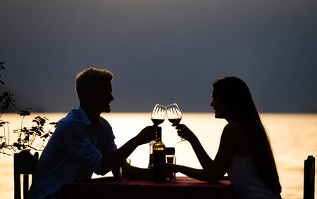 Young couple have romantic evening on sea beach