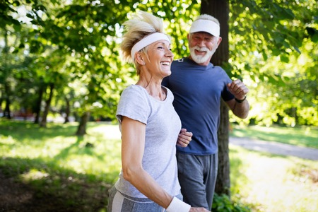 Happy senior people running to stay helathy and lose weight Stok Fotoğraf