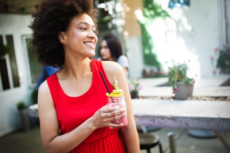 Healthy drinks, diet and people concept. Close up of beautiful afro woman Stock Photo