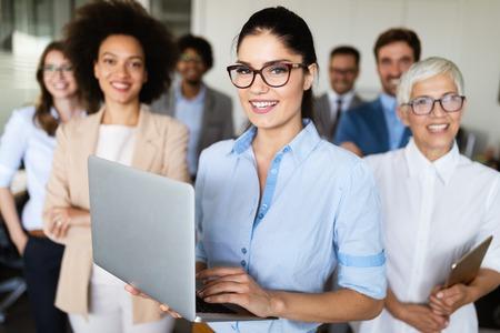 Portrait of business team posing in office Фото со стока