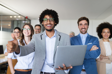 Successful company with happy workers in office Stock Photo