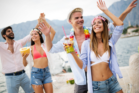 Summer, vacation, party, people concept. Group of friends having fun and party on the beach. Imagens