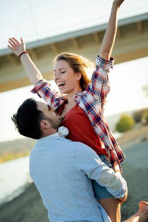 Truly happy playful couple having fun at beach 版權商用圖片