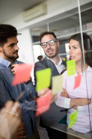 Business people meeting at office and use sticky notes to share idea