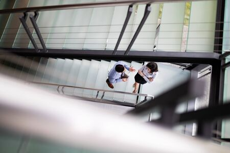 Businessman and Business woman go up the stairs Foto de archivo - 124706189