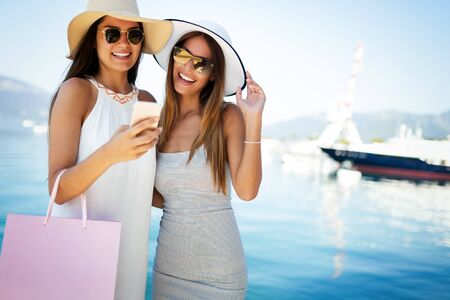 Luxurious life for two women walking and shopping on vacation