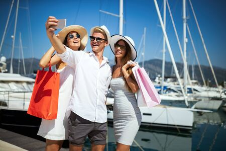 Group of young friends people doing selfie after shopping