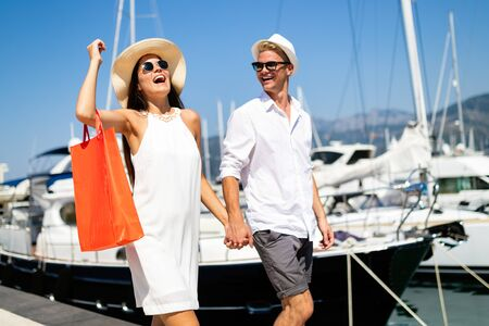 Couple on summer vacation enjoying travel and shopping