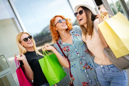 Beautiful women with shopping bags walking at the mall Stock Photo