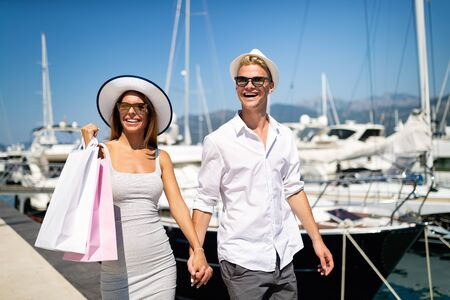 Happy couple on summer vacation shopping and sightseeing