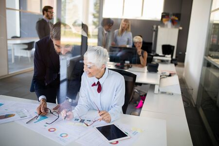Business colleagues working in modern conference room Stock Photo