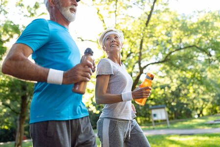 Happy senior couple staying fit by sport running Stock Photo