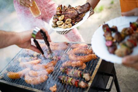Delicious grilled meat with vegetables over the coal on barbecue