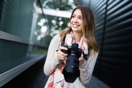 Woman is a professional photographer with dslr camera