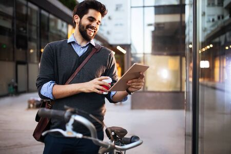 Young man online via a digital tablet in the city Stock Photo