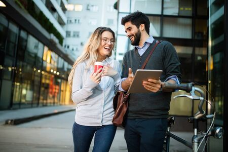 Happy young couple using a digital tablet together and smiling Stock Photo