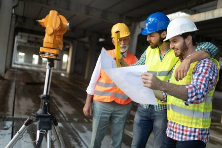 Group of construction engineer working in construction site Banco de Imagens - 124967541