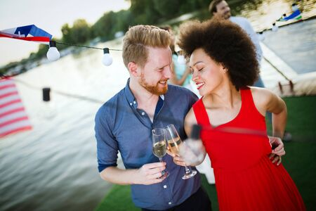 Romantic happy couples dancing and drinking at party Stock Photo