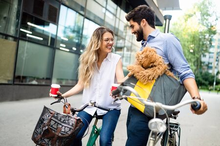 Romantic couple is having rest in the city with dog and bicycles Imagens