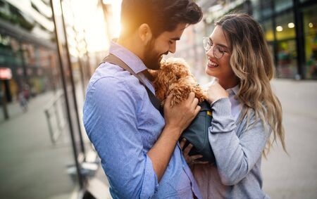 Romantic couple is having rest in the city with dog
