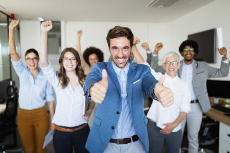Successful group of business people at work in office Stock Photo