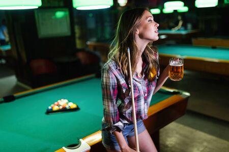 Young happy girl having fun with billiard. Play and fun concept. Archivio Fotografico - 127844966
