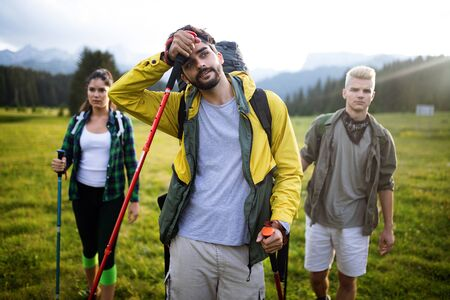Hard, difficult, tiring and exhausting expedition of four friends in wild Stock fotó