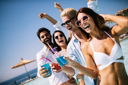 Group of friends having fun on summer vacation. Lifestyle, friendship, travel and holidays concept 写真素材 - 128904106