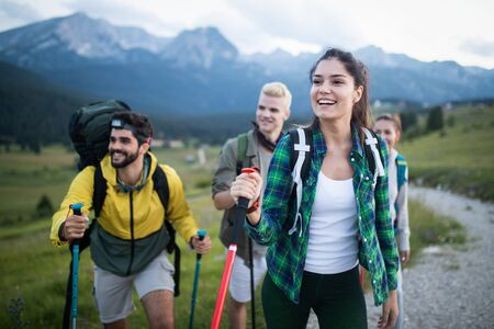 Group of hikers walking on a mountain and smiling