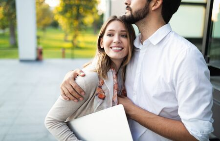 Happy young couple hugging and laughing outside Stock fotó