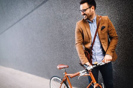 Happy businessman riding bicycle to work in morning Stock fotó - 129312217