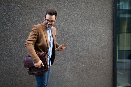 Handsome male marketing experts walking on city street going to visit meeting conference Stock fotó - 129316270