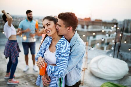 Friends having party on top of the roof. Fun, summer, city lifestyle and friendship concept Banco de Imagens - 129317422