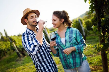 Portrait of happy people spending time in vineyard