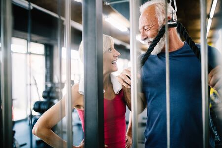 Happy fit mature man in gym working out to stay healthy Zdjęcie Seryjne